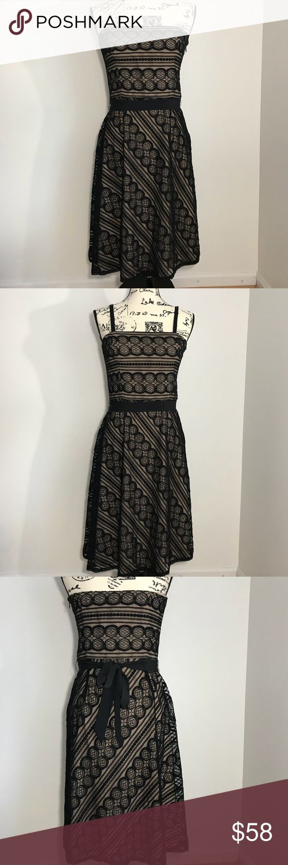 """LOFT Black Lace Nude Evening Cocktail Dress Sz 6 LOFT Women's Black Lace Nude Evening Cocktail Dress Size 6  Preowned excellent condition shell: 60% cotton, 40% nylon lining 100% polyester Black lace and nude underlay, removable adjustable straps, black tie belt that can also be removed  side zipper closure with clasp All measurements are approximate and taken while laying flat: armpit to armpit 16"""" length 34"""" LOFT Dresses"""