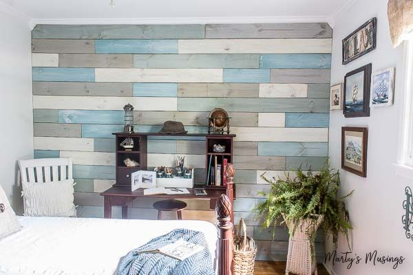 This gives me a great idea for a framed outdoor fence piece! - How to DIY a Plank Wall With Chalk Paint for Under $100!