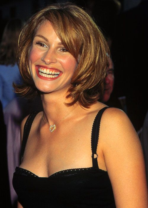 Julia Roberts.  ~I LOVE this hairstyle/cut! This is the longest I'd ever want my hair! :)