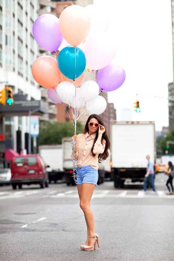 I absolutely love this photography when you are holding a bunch of fun colored balloons in the street!!
