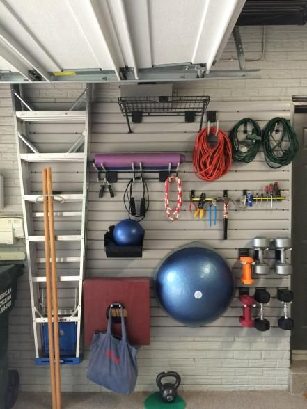 Long for a workout space but lack a spare room? Take advantage of a garage wall to install everything you need to stay in shape. This wall-mounted gym installed by Tailored Living consists of a slat-wall storage system that makes it easy to customize.
