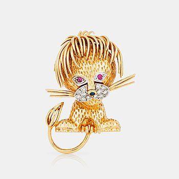 BROSCH i form av ett lejon, med briljantslipade diamanter samt rubiner.