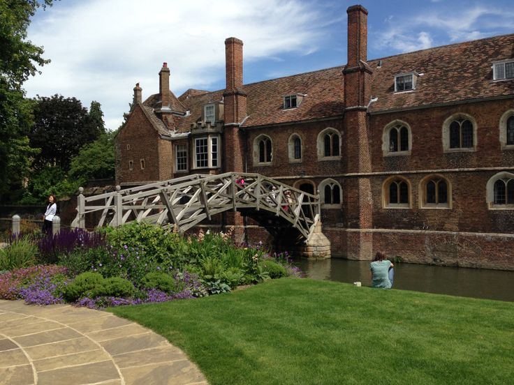 Queens' College, Cambridge Mathematical Bridge with newly planted garden bed - purple and blue mix of salvias, geraniums, irises and more