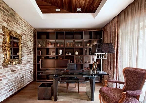 Totally doing this in our office: Brick wall with built in shelves on the other wall. LOVE IT!