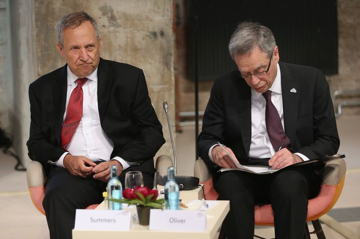 Lawrence Summers Photos Photos - Former U.S. Secretary of the Treasury Lawrence Summers (L) and Canadian Minister of Finance Joe Oliver attend a symposium during a meeting of finance ministers of the G7 group of nations on May 28, 2015 in Dresden, Germany. The G7 finance ministers are meeting ahead of the upcoming G7 summit at Schloss Elmau in June. - G7 Finance Ministers Meet in Dresden