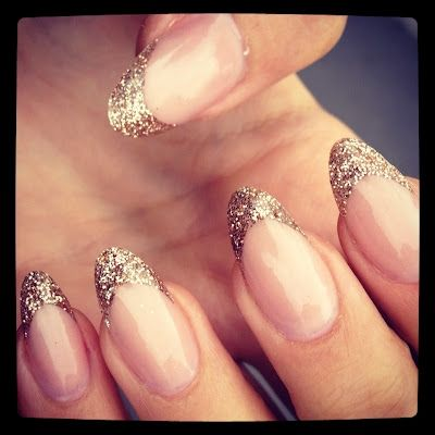gold glitter almond nails. I actually like these almond shaped nails.
