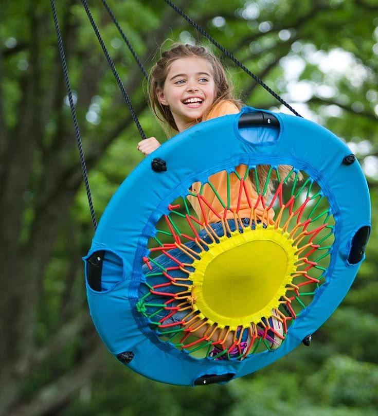 Hmm -- a bit of repurposing on a small trampoline with some bungee cords and voilà, an awesome tree swing!