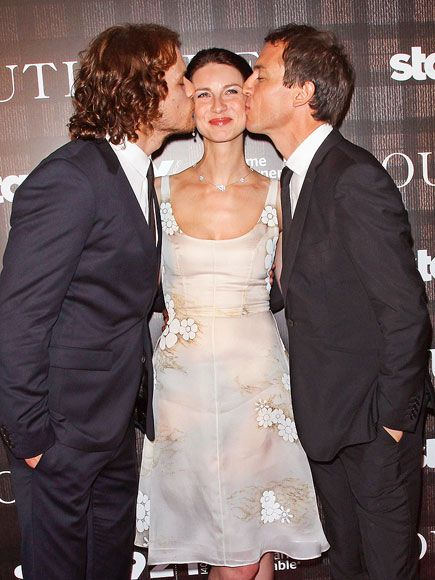 Star Tracks: Tuesday, July 29, 2014 | LIP ACTION | That's one lucky girl! Caitriona Balfe gets caught in the middle of her Outlander costars Sam Heughan and Tobias Menzies at a screening of their series at the 92nd Street Y on Monday in New York City.