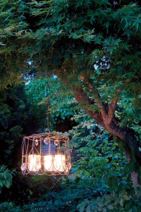 Lights in the garden in the evening are so atmospheric. This vintage chandelier is made out of old fashioned heavy duty wire. Glass jelly jars are used for holding the candles. Vintage crystals & glass drops are used to adorn the light. More than one would look fabulous. By day, or for a party, the jars could be filled with cut flowers.