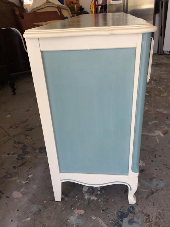 Beautiful custom painted antique dresser. French provincial. Hand painted with top quality Annie Sloan chalk paint. Colors are Duck Egg and Old White. Waxed to a beautiful finish. Solid wood dresser in great condition. So pretty, serpentine drawers. Lightly distressed. Top finished with a