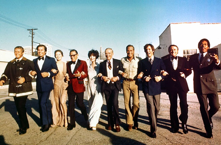 The all-star cast of The Towering Inferno (1974). From left: Steve McQueen, Robert Wagner, Faye Dunaway, William Holden (best tux ever), Jennifer Jones, Fred Astaire, Paul Newman, Richard Chamberlain, Robert Vaughn and O.J.