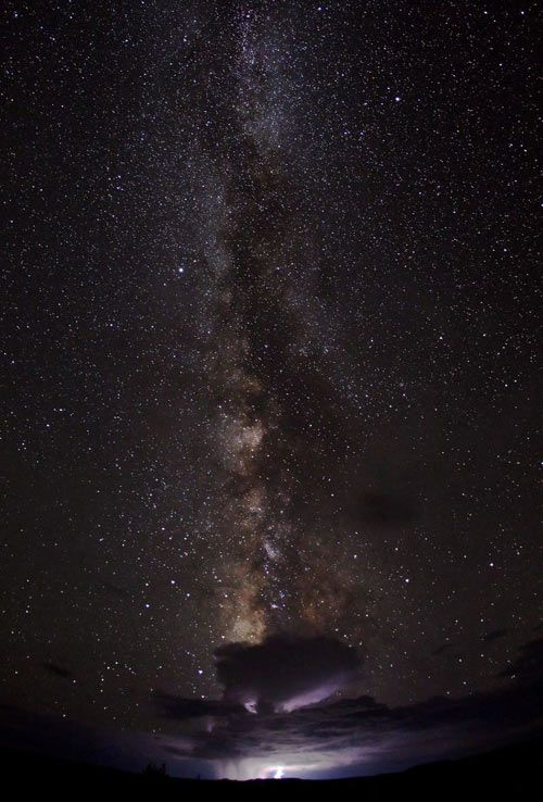 """""""The Milky Way towering over a thunderstorm in Canyonlands National Park"""" by Bret Webster"""