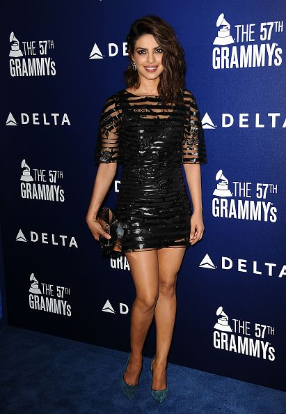 At Delta's Pre-Grammy party in a Blumarine dress and Casadei shoes. - ELLE.com
