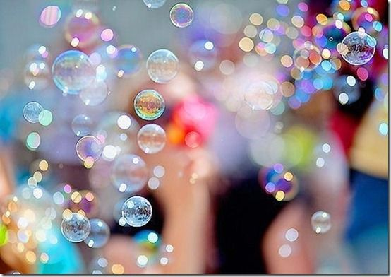 Bubble birthday theme...clear balloons, bubbles everywhere, glass ornaments in vases, clear balls floating in pool, bubble wrap, bubble gum, bubble bath