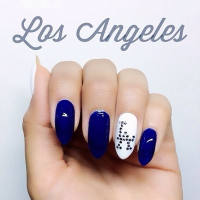 Dodger blue tips except the ring and pointer.... LA on both. Yeah
