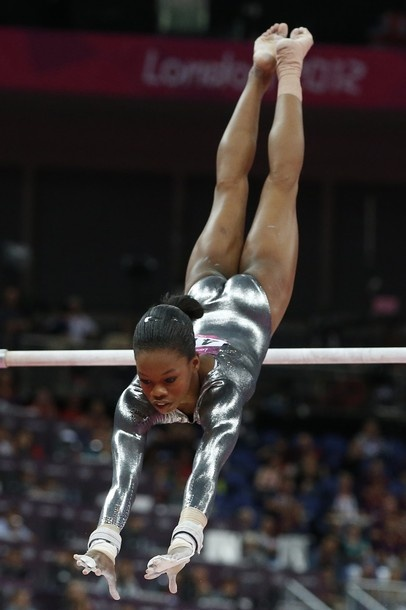 US gymnast Gabby Douglas performs during the women's uneven bars of the artistic gymnastics event of the London Olympic Games on August 6, 2012 at the 02 North Greenwich Arena in London.