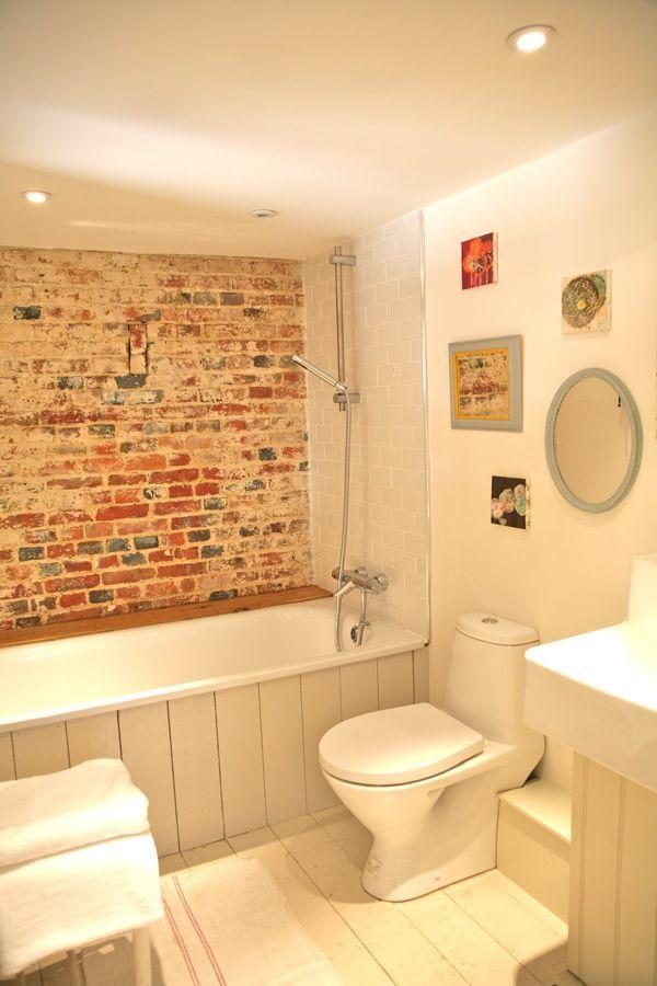 exposed brick in bathroom / bath surround
