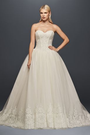 The combination of a structured, figure-flattering corset and a tulle skirt edged in ornate lace appliques creates a wedding dress that is both glamorous and romantic.   Truly Zac Posen, a David's Bridal exclusive  Polyester  Chapel train  Back zipper; fully lined  Dry clean  Imported  Also available in extra length