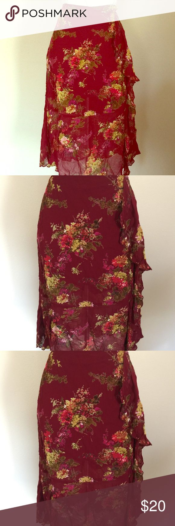 "Newport News Romantic Floral Burgundy Pencil Skirt Newport News Romantic Floral skirt in Burgundy. Skirt has a wrap front, with Ruffle trim. It is a pencil style skirt, made of rayon with a polyester lining. Great for work, or a date night. Worn and dry cleaned, it is in MINT condition. Tagged a size 12, it measures 32"" at the waist, 42"" at hip, and length is 27"" Newport News Skirts Midi"