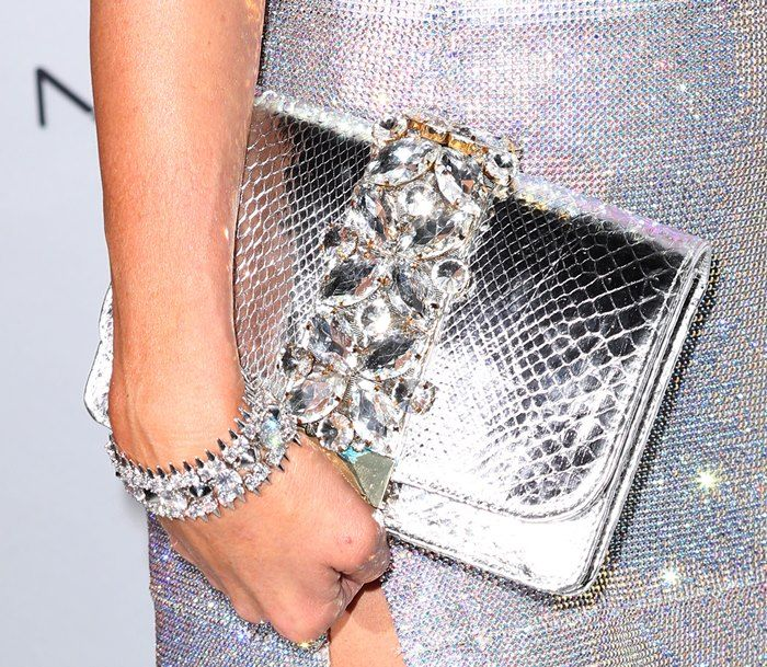 Paris Hilton carrying a silver handbag at the Hollywood Beauty Awards