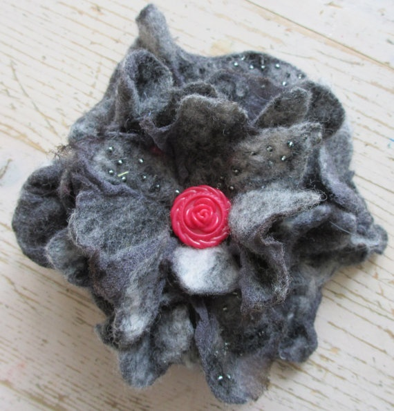 Black flower brooch by Nicole de Boer via Etsy