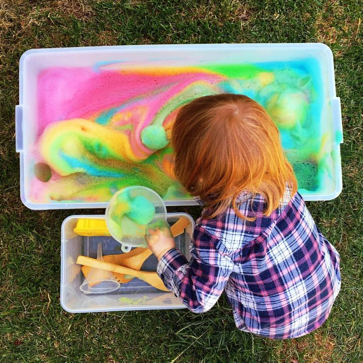 Magic, foamy, rainbow bubbles, perfect for scooping, pouring, mixing and squishing! To make, use an electric mixer to combine dishwashing liquid, food colouring and a little water. Sensory play fun!