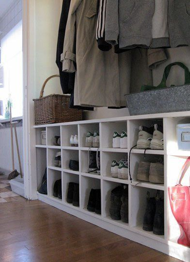Shelves for shoes and/or baskets of seasonal clothing (ideally, different ones for each of us), with coat rod/hooks above. From: Entryways for Any Apartment | Apartment Therapy