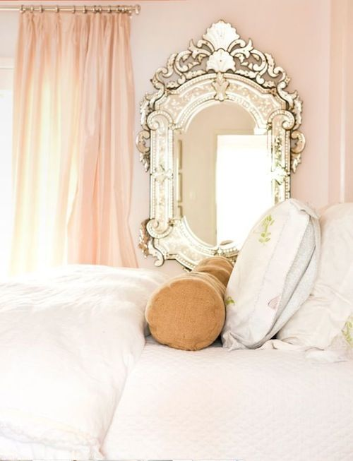 blush and white bedroom with a fancy mirror.  too girly for master though.  i just can't do that to alan.  guest room?
