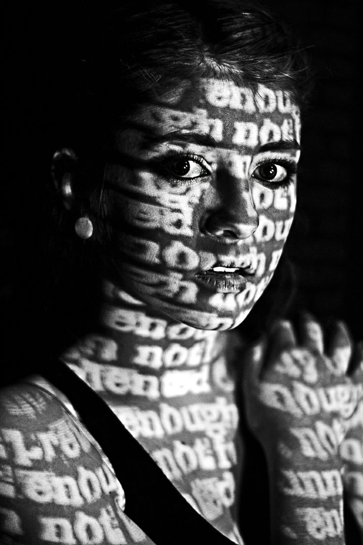 "Projected words such as ""Not good enough"", ""not smart enough"", and ""not pretty enough"" onto her skin using a simple classroom projector."