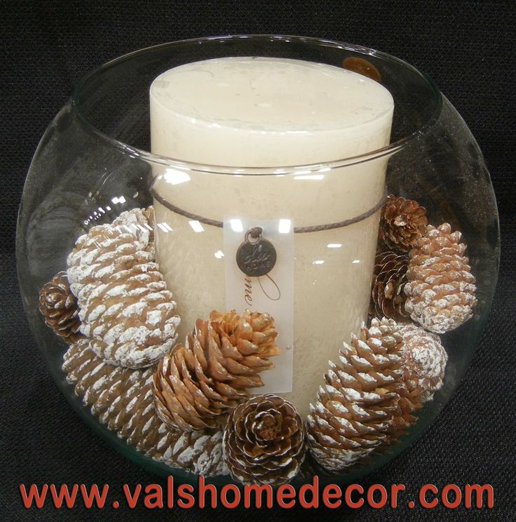 Candle with pinecones. Christmas centerpiece