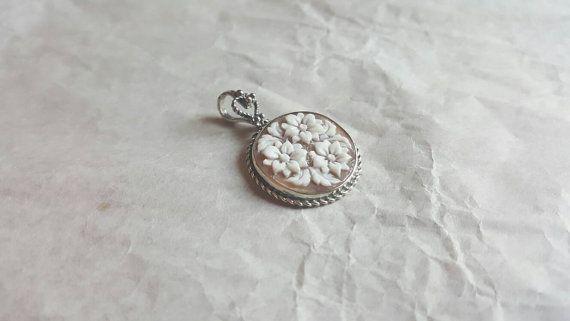 Vintage cameo pendant with handmade flowers.  #donadiocameo #cameojewelry #pendant #cameopendant #flowers