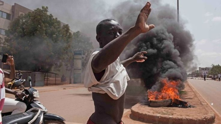 Presidential guard officers in Burkina Faso seize power in a coup, with more than 10 people reportedly killed as protests break out in the capital.
