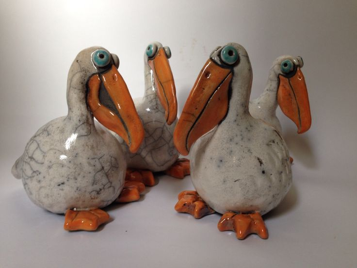 RAKU Pelicans, hand made using a pinch pot technique.  These are fun to look at as they each have a different expression. Made to order. www.thesilverdoorhandsonarts.com