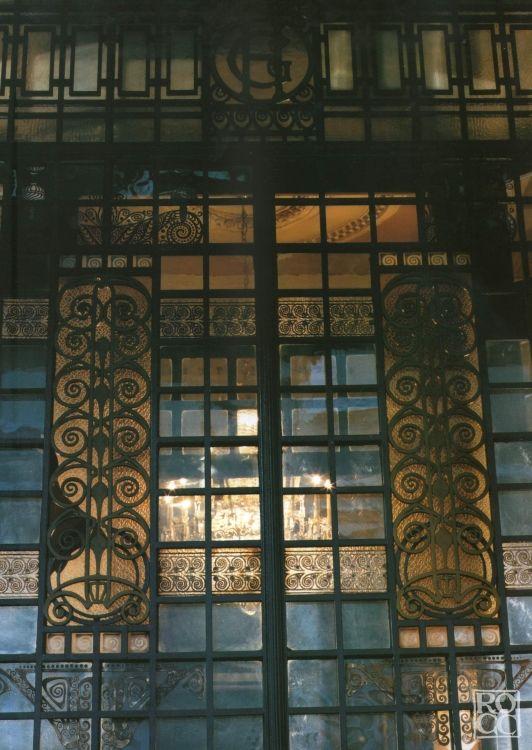 """Galileo Chini (Firenze 1873 - 1956), """"PORTA D'INGRESSO DEL GRAND HOTEL LA PACE"""", 1910. Vetrata legata nella struttura metallica caratterizzata da girali floreali contrapposte a lastre geometriche.  Luogo: Grand Hotel """" La Pace """" Montecatini Terme Soggetto: Decorativo Tecnica: Tecnica mista Supporto: Serramento Materiale: Ferro e Vetro Misure h x l x p: 0 x 0 x 0  Galileo Chini: Repertorio delle Opere. info@repertoriogalileochini.it"""