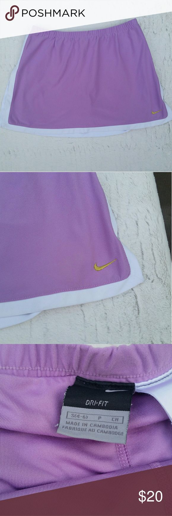 Nike Dri Fit Skirt Skort Golf Tennis Purple Small Women's Nike Skort  What a cute skirt in a gorgeous color! *Purple trimmed with White *Gold Nike Swoosh Symbol  *Skirt with Shorts underneat *92% Polyester 8% Spandex *Size Small (4-6)  Gently used clothing. No flaws or damage. Looks great!  Waist Laying Flat 12.5 inches Top of Waist to Hem 12.5 inches Of course there is stretch to the waistband on this item as well.  Please check these measurements against your own size before ordering as…