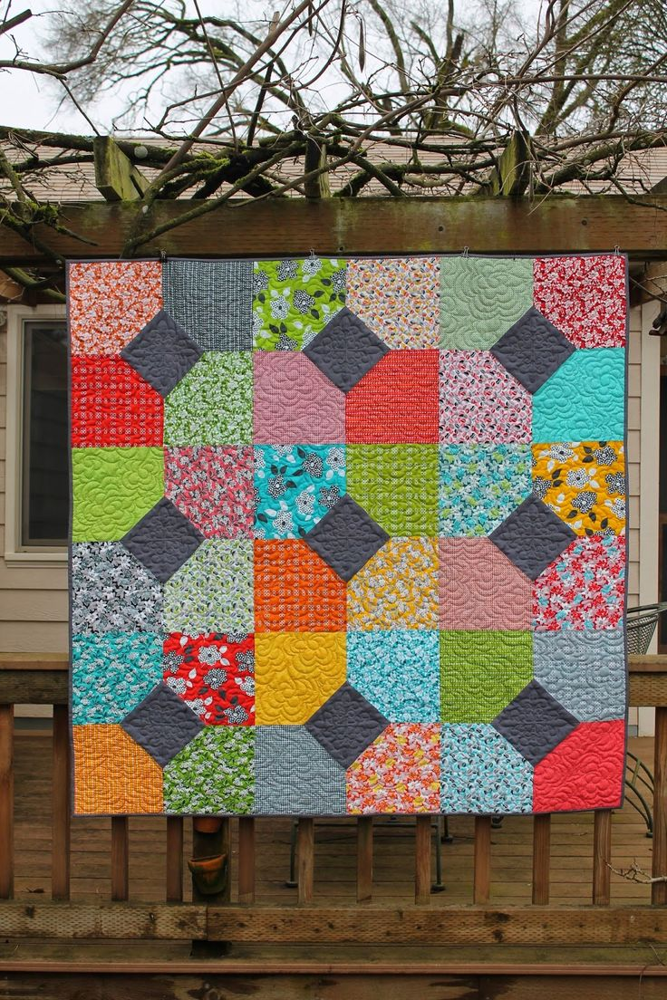 I am so excited because today I finally get to show off this beautiful quilt I made using the Fat...