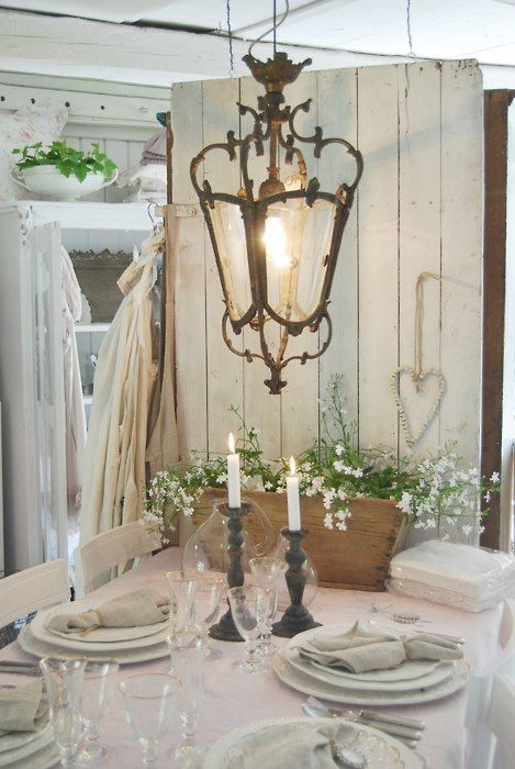 rustic antique white door used as back drop by table...love the hanging lantern,...