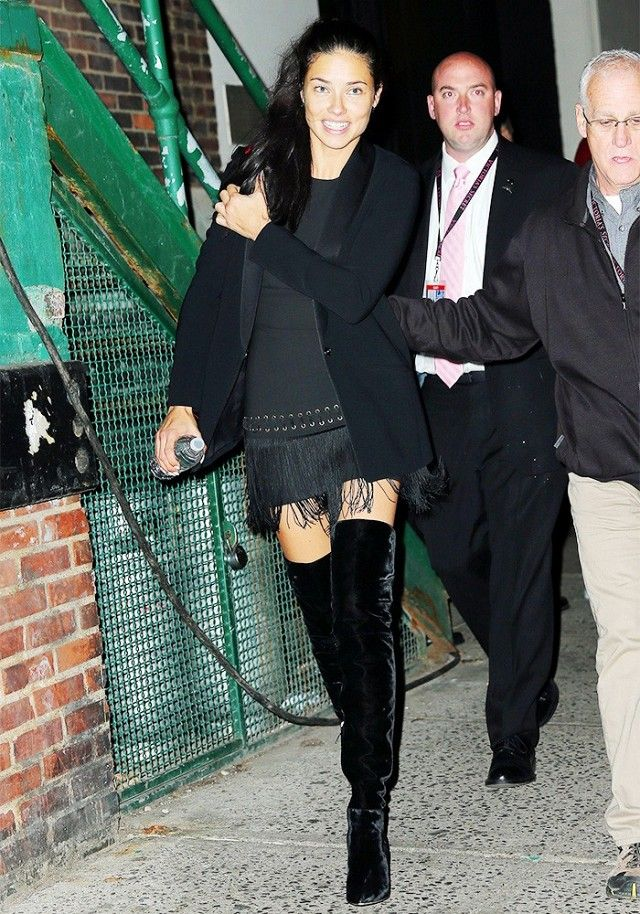Adriana Lima wears an Elizabeth and James Morin Shawl Label Blazer and Eron Dress with black over-the-knee boots.