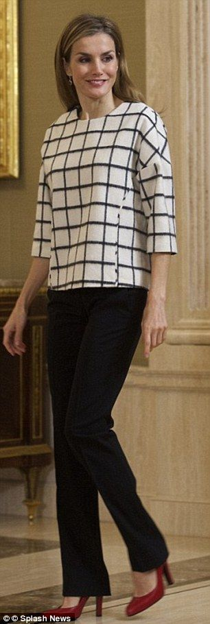 Letizia wearing the Hugo Boss top in November 2014 at a charity event at Zarzuela Palace...