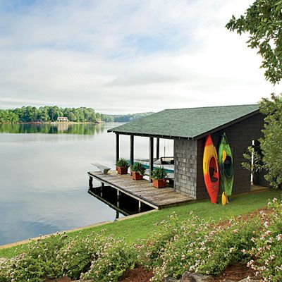 """I want to find an old kayak I can repaint to display like this on the boathouse. Cute and """"lakey"""" looking.  (We like to kayak.)  I also love the plants on the dock."""