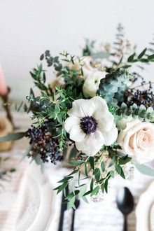 Smaller, more neutral bouquets of  ruscus, ivory spray roses, navy privet berries, dusty blush quicksand roses, varied winter foliage, parvifolia eucalyptus, white anemones and a very subtle hint of burgundy amaranthus