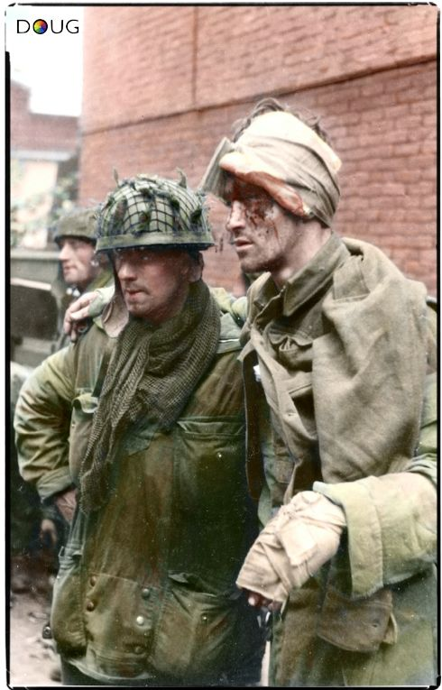 L/Cpl Paddy McGiven, Sapper Charles Grier and wounded Sapper Dick Robb all from B troop, 1 Para Squadron, Royal Engineers. This picture was taken at 1530hrs on Wednesday the 20th September 1944, in a builders yard near their last position held at the Van Limburg Stirum School in Arnhem.