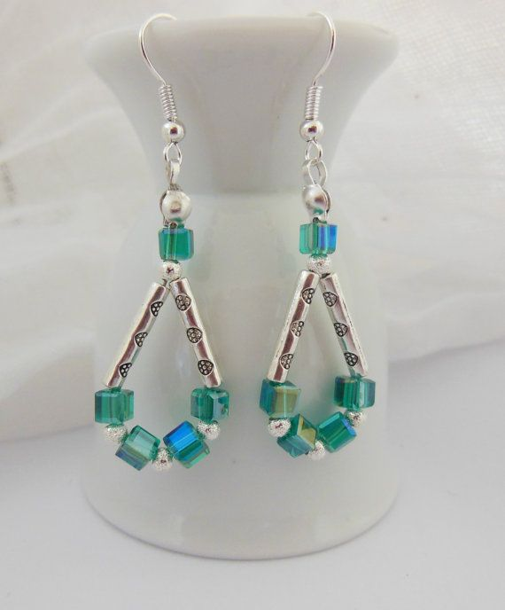 Stamped metal tubes and bluegreen crystal cube by LeelysBeads, €9.50