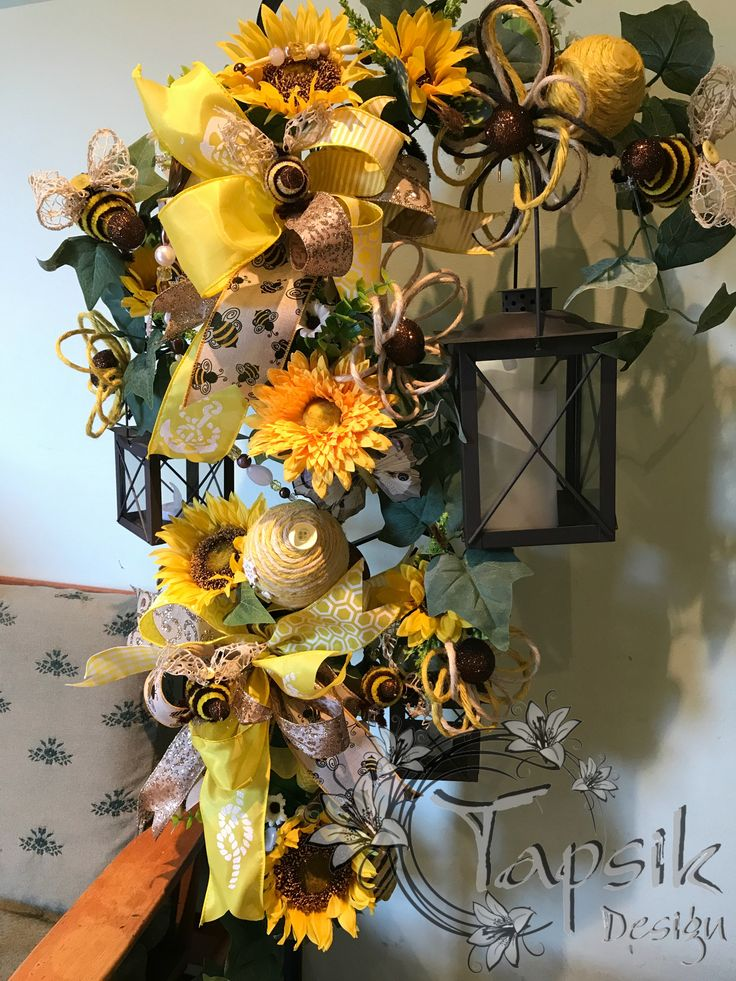 Sunflower Lantern Stand Decoration. So i started to decorate the house for summer. Decorated our lanterns on a stand. Of course with handmade bees, decorations, bead garland. Two bows, sunflowers, greenery. And since i like to try new stuff, so i tried to decorated the yellow ribbon with a bit of nautical decor. Happy that it worked out.
