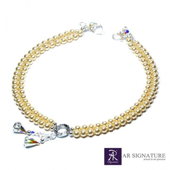 AR Signature Pearls of Monaco, Fully handcrafted with Genuine Swarovski® Elements and pearls.  With Aurora Borealis color for the crystal and cream color's pearls, made this jewelry look simple yet stunning for most party where you want to look like a princess..
