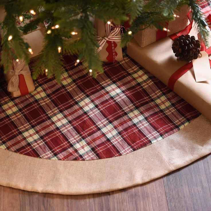 Give your beautifully wrapped presents a festive back drop with our Red Tartan Plaid Christmas Tree Skirt. With bright red hues and burlap accents, this festive tree skirt has a classic, Christmas look.