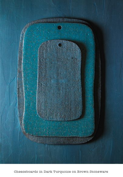 Gorgeous cheeseboard in dark turquoise.