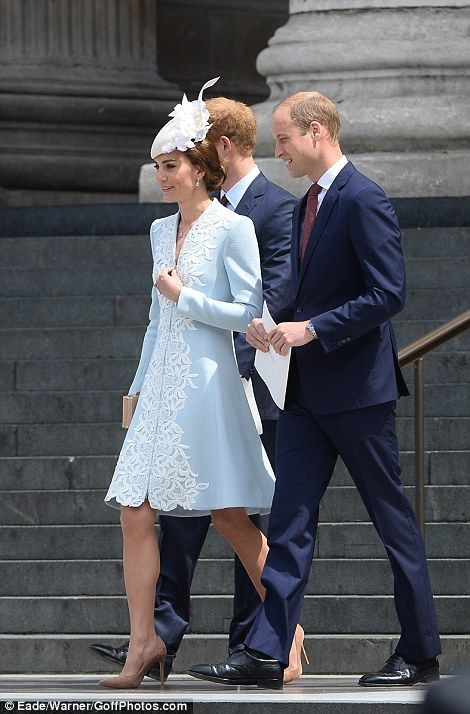 Prince William and Kate smile as they leave the service alongside Prince Harry