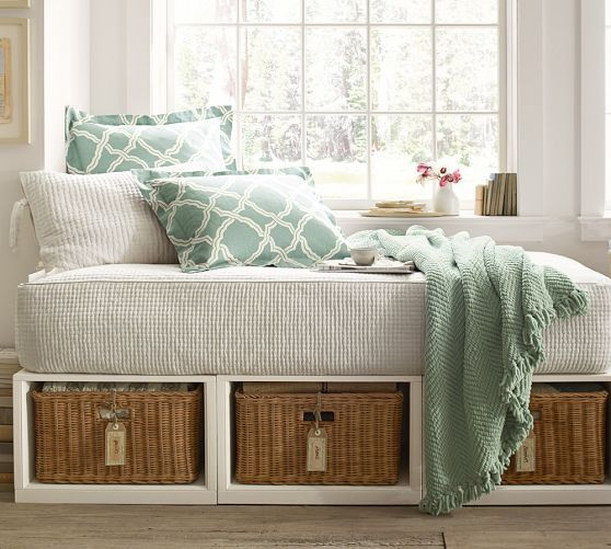 Stratton Daybed with Baskets | Pottery Barn - Love this idea for a reading nook in a play room or unused corner.