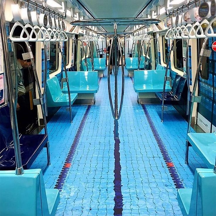 the subway cars were made to resemble swimming pools, soccer fields, basketball courts and race tracks.